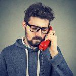 Sad man having phone call