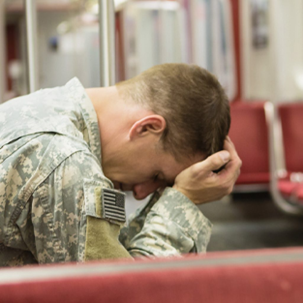 Depressed soldier on the train