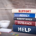 "Stack of books with titles, ""Support, Advice, Acceptance, Guidance, and Help"""