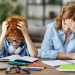 Mother is stressed and has headache and helping son with homework