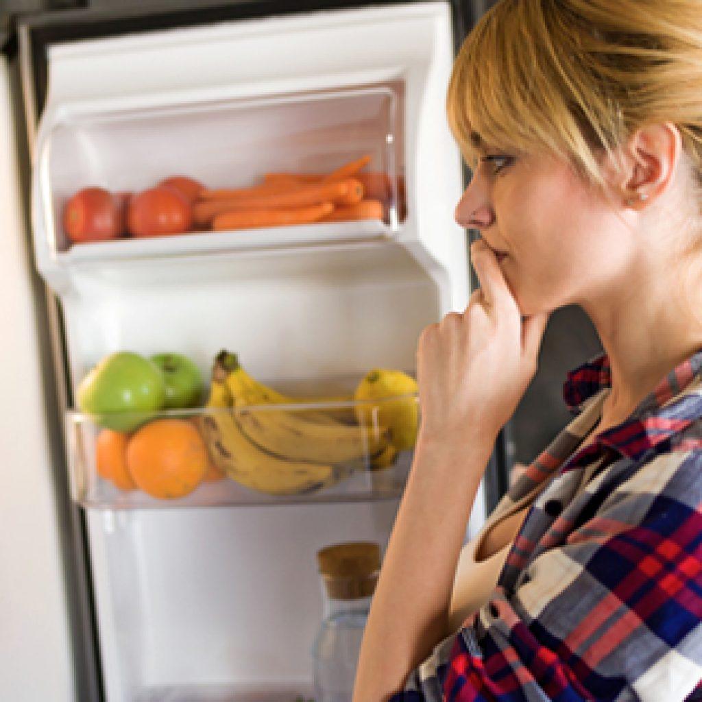 woman at fridge